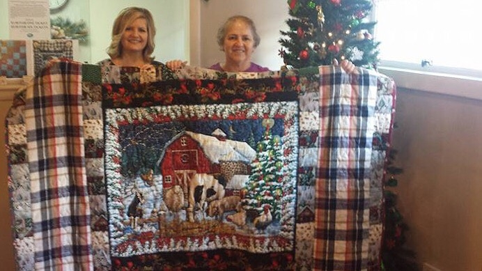 Debra Stockard (left), executive director of the Pregnancy Resource Center of South Central Missouri, with Linda Wood (right), winner of this beautiful quilt