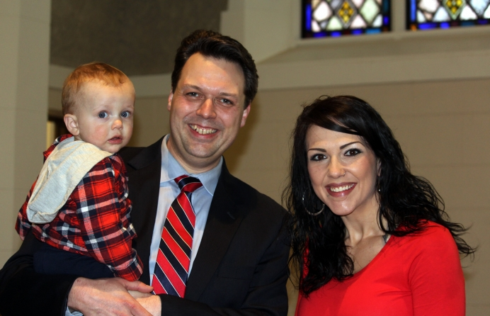 Dr. Zachary Vreeman of First Presbyterian Church with Acacia Boyes and her son, Axton.
