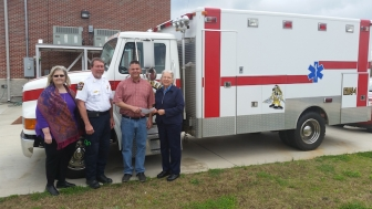Sandy Parker and Connie Frappaolo of First Source with fire chief Roger Green and mayor Ken Nail