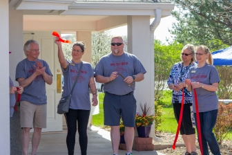 Members of the Chamber of Commerce conducted the ribbon-cutting, opening Women's Resource Center's new location this May.