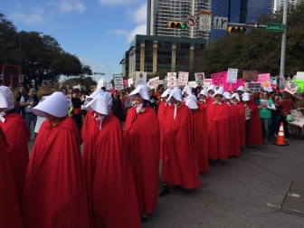 """Texas Handmaids"" demonstrating their opposition to non-abortive pregnancy options in Austin, Texas"